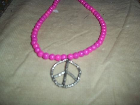 Shiny! .  Make a pendant necklace in under 10 minutes by beading, jewelrymaking, and jewelrymaking with beads and pendant. Inspired by clothes & accessories, peace signs, and peace signs. Creation posted by Ashley P. Difficulty: Easy. Cost: Absolutley free.