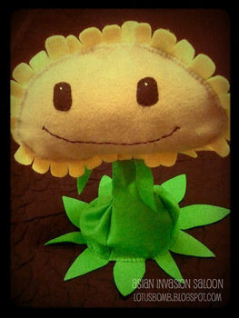 The cute and kawaii Singing Sunflower from P&E and World of Warcraft .  Make an object plushie by needleworking, sewing, and sewing with felt. Inspired by flowers and floral. Creation posted by lotusbomb. Difficulty: 3/5. Cost: Cheap.