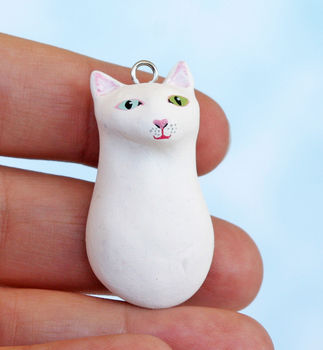 A kitty I can take anywhere! .  Sculpt a clay animal necklace in under 180 minutes by creating and molding with acrylic paint, paint brush, and clay. Inspired by cats, creatures, and kawaii. Creation posted by Jill. Difficulty: 4/5. Cost: Cheap.