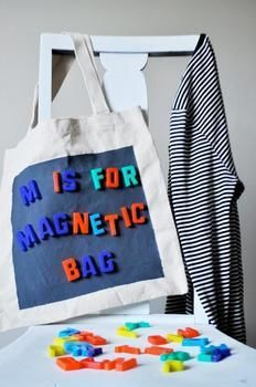 Create a magnetic tote bag to keep kids happy (& quiet) while out to eat or during a long car ride .  Free tutorial with pictures on how to make an embellished tote in under 20 minutes by decorating and sewing with masking tape, bag, and foam brush. How To posted by Chrissann G. Difficulty: Easy. Cost: Cheap. Steps: 5