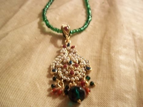 Swanky! .  Make a beaded pendant in under 10 minutes by beading and jewelrymaking with pendant. Inspired by indian and clothes & accessories. Creation posted by Ashley P. Difficulty: Easy. Cost: Absolutley free.