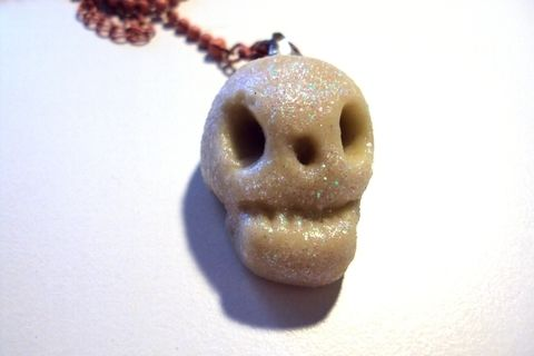 A fashion must: a shiny skull pendant to rock your outfit. .  Sculpt a clay character necklace in under 20 minutes by  with glue, glitter, and clay. Inspired by skulls & skeletons. Creation posted by Juliet J. Difficulty: Simple. Cost: No cost.