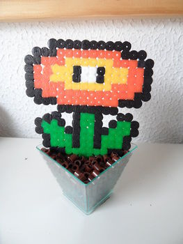 Super mario bros! .  Free tutorial with pictures on how to make a beaded flower in under 10 minutes using perler beads. Inspired by super mario, geeky, and kawaii. How To posted by Silene6. Difficulty: Easy. Cost: Absolutley free. Steps: 1