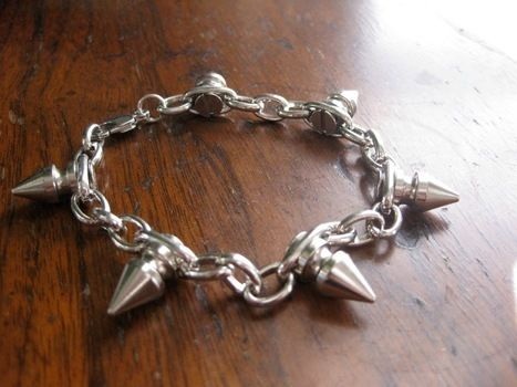 DIY Cone Stud Spike Bracelet .  Free tutorial with pictures on how to make a spike bracelet in under 30 minutes by jewelrymaking with jump rings, chain, and pliers. How To posted by Erin P. Difficulty: Simple. Cost: Cheap. Steps: 8