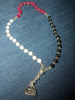 A Pagan take on the classic Catholic Rosary. .  Make a rosary necklace in under 90 minutes by beading and jewelrymaking with beads, beads, and beads. Inspired by religious & spiritual and gothic. Creation posted by Amy T. Difficulty: Simple. Cost: Cheap.