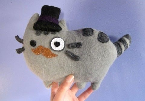 Lookin' spiffy! .  Free tutorial with pictures on how to make a cat plushie in under 90 minutes by sewing with felt, needle and thread, and marker pen. Inspired by cats, kawaii, and pusheen. How To posted by TheArtSwallow. Difficulty: Easy. Cost: Cheap. Steps: 28