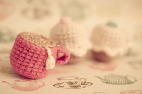 Take a tea party with you - everywhere you go! .  Stitch a knit or crochet keyring in under 150 minutes by needlepointing, yarncrafting, crocheting, and amigurumi with yarn, crochet hook, and sewing needle. Inspired by kawaii, cupcakes, and clothes & accessories. Creation posted by . Difficulty: Simple. Cost: Cheap.