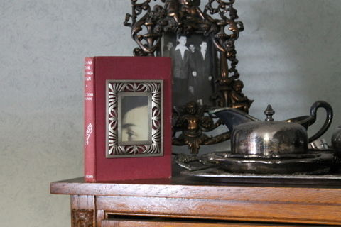 Display your photography!  .  Free tutorial with pictures on how to make a recycled photo frame in under 10 minutes by photographing and decorating with frame and book. Inspired by books, gothic, and vintage & retro. How To posted by LastKoalaBear. Difficulty: Easy. Cost: Absolutley free. Steps: 9