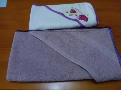 For the bigger baby, when the regular sizes don't cut it.. .  Make a tea towel by sewing and dressmaking with ribbon and bath sheet. Inspired by babies, baby showers, and kids. Creation posted by Teagan D. Difficulty: Easy. Cost: Cheap.