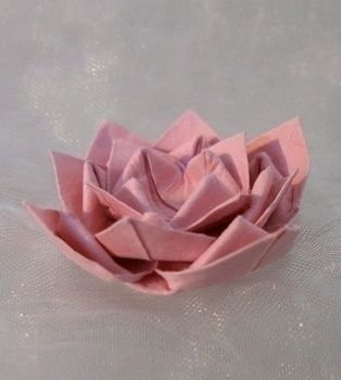 Gently floating on the wate. Wait! Don't do that, it's made of paper! .  Fold an origami lotus in under 20 minutes by paper folding with paper and glue. Inspired by flowers. Creation posted by Laurina-Helena. Difficulty: Simple. Cost: Absolutley free.