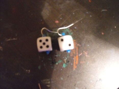 Boys nite out.. or not .  Make a pair of dice earrings in under 20 minutes by constructing, jewelrymaking, and not sewing with dice and earring loops . Creation posted by JimmyJamma. Difficulty: Easy. Cost: Absolutley free.