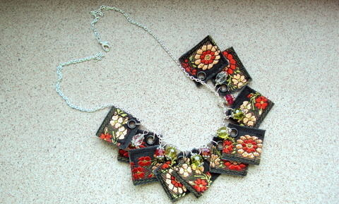 Decorative ribbon and glass beads necklace .  Make a ribbon necklace by jewelrymaking and sewing with hole punch, eyelets, and eyelet setter. Inspired by flowers and clothes & accessories. Creation posted by Rozantia P. Difficulty: 5/5. Cost: 3/5.