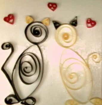 Two cats on a card by using the 'art of quilling' .  Make a quilled greetings card in under 180 minutes by quilling with card, white glue, and quilling tools. Inspired by cats, creatures, and hearts. Creation posted by Mitzzi. Difficulty: Easy. Cost: Absolutley free.