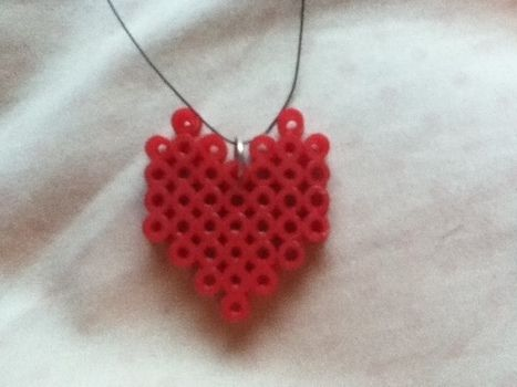 Old perler pieces I never wear :P .  Make a pegboard bead pendant in under 60 minutes using perler beads. Inspired by kawaii and hearts. Creation posted by :). Difficulty: Easy. Cost: Absolutley free.