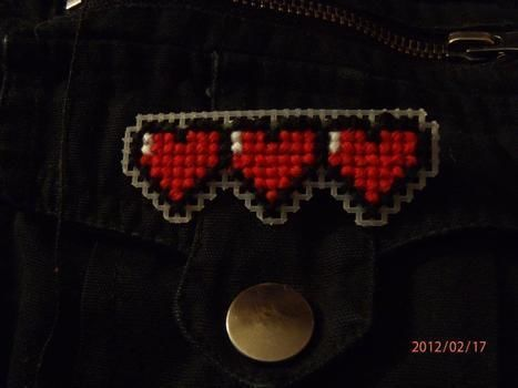 Legend of Zelda, pin, video game, cool. .  Free tutorial with pictures on how to embroider art in under 45 minutes by creating, needleworking, and cross stitching with safety pins, cross stitch thread, and cross stitch needle. Inspired by legend of zelda, gothic, and punk. How To posted by Dana B. Difficulty: Easy. Cost: Cheap. Steps: 4