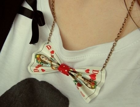 Alice.. .  Free tutorial with pictures on how to make a toy necklace in under 20 minutes by jewelrymaking with ribbon, chain, and hot glue. Inspired by alice in wonderland, kawaii, and clothes & accessories. How To posted by Anna H. Difficulty: Easy. Cost: No cost. Steps: 4