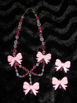 Pink bows and beads necklace .  Sew a bow necklace in under 120 minutes by beading, jewelrymaking, wireworking, and not sewing with beads, pliers, and needle nose pliers. Inspired by vintage & retro, kawaii, and clothes & accessories. Creation posted by Kez N. Difficulty: Simple. Cost: Cheap.