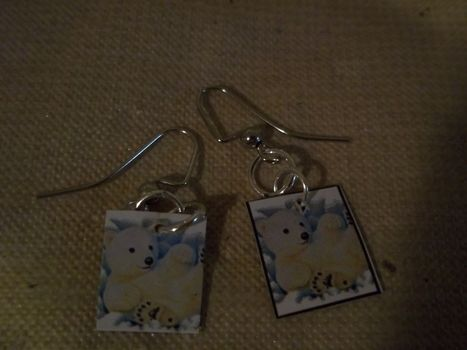 Sticky! .  Make a pair of recycled earrings in under 30 minutes by jewelrymaking with earring hooks, cardboard, and stickers. Inspired by animals, bears, and flowers. Creation posted by Ashley P. Difficulty: Easy. Cost: No cost.