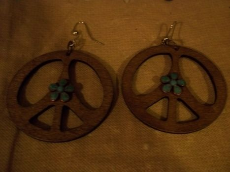 Peace out! .  Make a pair of pendant earrings in under 2 minutes by jewelrymaking and jewelrymaking with jump rings, earring hooks, and pendant(s). Inspired by clothes & accessories, peace signs, and peace signs. Creation posted by Ashley P. Difficulty: Easy. Cost: Absolutley free.