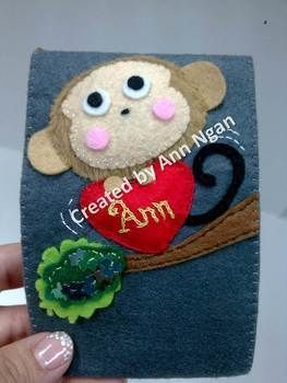 Show this kawaii handmade bag to your love one^^ .  Sew a fabric animal pouch in under 180 minutes by needleworking, sewing, and felting with felt, buttons, and velcro. Inspired by crafts, monkeys, and hearts. Creation posted by Ann N. Difficulty: Simple. Cost: Cheap.