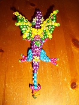 On flowered wings... .  Bead a beaded dragon by beading, jewelrymaking, and wireworking with beads, beads, and beading wire. Inspired by dragon. Creation posted by Lyssa C. Difficulty: 5/5. Cost: Cheap.