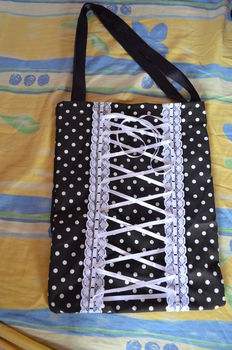 ..laces, polka dot, blanc and white.. need more to love this ? .  Make an embellished tote in under 180 minutes using imagination. Inspired by clothes & accessories. Creation posted by Demonymphetamine. Difficulty: 3/5. Cost: Cheap.