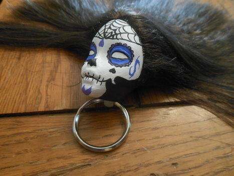 Sugar skulls make everything better :) .  Make a toy charm in under 120 minutes by creating and decorating with acrylic paint, key ring, and barbie doll. Inspired by gothic, kawaii, and sugar skulls. Creation posted by puppycat1. Difficulty: Simple. Cost: Absolutley free.