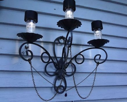 Super easy and cheap, yet it looks so freakin' fancy! .  Free tutorial with pictures on how to make a chandelier in under 90 minutes by spraypainting and decorating with hot glue gun, spray paint, and decorations. How To posted by Aidith R. Difficulty: Simple. Cost: Cheap. Steps: 13
