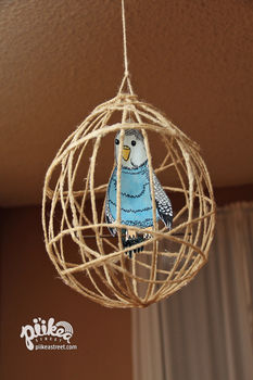 Cute hanging decoration for your home. .  Make a wire model in under 180 minutes by drawing, yarncrafting, and wireworking with yarn, paper, and glue. Inspired by animals, birds, and birdcages. Creation posted by . Difficulty: Simple. Cost: Cheap.