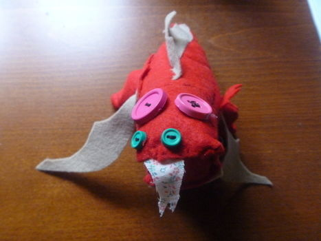 A little dragon fireball  .  Make a food plushie by sewing with felt, thread, and buttons. Inspired by domo kun, domo kun, and domo kun. Creation posted by Marisa B. Difficulty: 4/5. Cost: 3/5.
