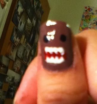 Nom nom nom on your nail  .  Paint a character nail in under 15 minutes by nail painting and nail painting with nail polish. Inspired by monsters. Creation posted by Joanne N. Difficulty: Easy. Cost: Cheap.
