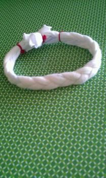 From an old, unwanted t-shirt .  Make a braided fabric bracelet in under 5 minutes by braiding and jewelrymaking with t shirt and crochet thread. Inspired by clothes & accessories. Creation posted by Rara. Difficulty: Easy. Cost: No cost.