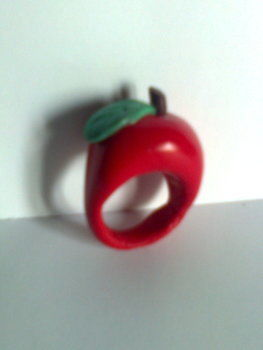An apple a day.. What a cliché .  Make a clay ring in under 60 minutes by jewelrymaking and molding with polymer clay and polymer clay glaze. Inspired by apples. Creation posted by Minimax. Difficulty: Easy. Cost: Absolutley free.