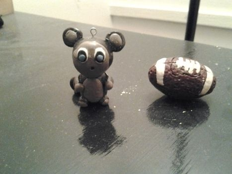 Clay figures of monkey and a football .  Mold a clay animal in under 60 minutes by molding with polymer clay glaze and polymer clay glaze. Inspired by football. Creation posted by Celestine . Difficulty: Simple. Cost: Cheap.