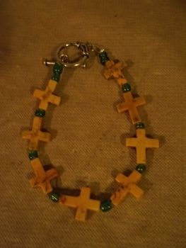 Carry the cross! .  Make a wooden bracelet in under 10 minutes by beading and jewelrymaking with beads. Inspired by religious & spiritual, clothes & accessories, and crosses. Creation posted by Ashley P. Difficulty: Easy. Cost: No cost.