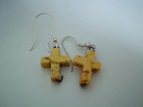 Crosses galore! .  Make a pair of cross earrings in under 2 minutes by jewelrymaking with beads and earring hooks. Inspired by religious & spiritual, clothes & accessories, and crosses. Creation posted by Ashley P. Difficulty: Easy. Cost: Absolutley free.