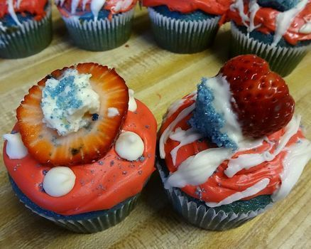 Awesomely simple patriotic cupcakes! .  Free tutorial with pictures on how to bake a flag cake in under 75 minutes by baking with sugar, food coloring, and strawberries. Inspired by 4th of july. Recipe posted by Aidith R. Difficulty: Simple. Cost: Cheap. Steps: 12