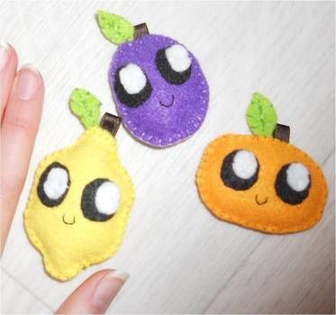Cute fruits made of felt. .  Make a lemon plushie in under 40 minutes by sewing with felt and ribbon. Inspired by kawaii. Creation posted by Tilda. Difficulty: Easy. Cost: Absolutley free.