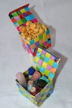 Great for party favors or stashing stuff! .  Free tutorial with pictures on how to weave a woven paper box in under 60 minutes by papercrafting, paper folding, and weaving with scissors, glue, and magazine. How To posted by Gaby R. Difficulty: 4/5. Cost: Absolutley free. Steps: 16