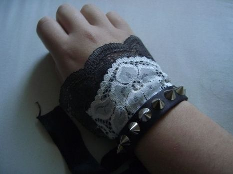 Antique flare .  Free tutorial with pictures on how to make a cuff in under 20 minutes by sewing and studding with lace, lace, and satin ribbon. Inspired by gothic and vintage & retro. How To posted by Raven Beauty . Difficulty: Easy. Cost: No cost. Steps: 5