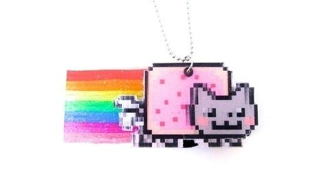 """The """"world's first animated GIF"""" lenticular necklace with audio for Lauren Out Loud! .  Free tutorial with pictures on how to make a plastic necklace in under 80 minutes by jewelrymaking with scissors, hot glue gun, and iron. Inspired by nyan cat. How To posted by Cat Morley. Difficulty: 3/5. Cost: Cheap. Steps: 20"""