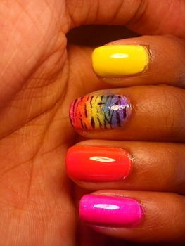 Zebra colorful nail art .  Paint an animal print nail by nail painting and nail painting with nail polish, nail polish, and nail polish. Inspired by clothes & accessories and zebra print. Creation posted by ShaeShai. Difficulty: Simple. Cost: Cheap.