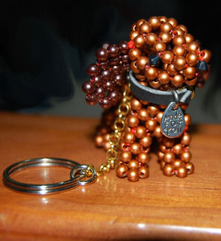 Filled with Puppy Love and Cuteness! .  Make a beaded animal in under 180 minutes by beading, creating, and beading with charms, leather, and pearl beads. Inspired by crafts, gifts, and creatures. Creation posted by CazSteele. Difficulty: 4/5. Cost: Cheap.