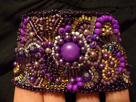 Beaded Bling .  Make a beaded cuff by beading, needleworking, and embroidering with thread, beads, and elastic band. Inspired by clothes & accessories. Creation posted by Anria O. Difficulty: Simple. Cost: 3/5.
