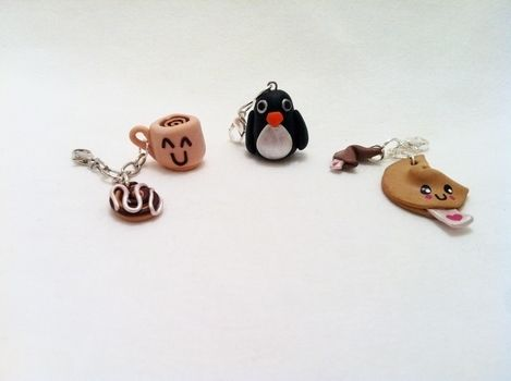 Charms made for friends .  Mold a piece of clay food in under 120 minutes by jewelrymaking, molding, and decorating with acrylic paint, polymer clay, and jewelry wire. Inspired by creatures, kawaii, and penguins. Creation posted by Pam. Difficulty: 3/5. Cost: No cost.