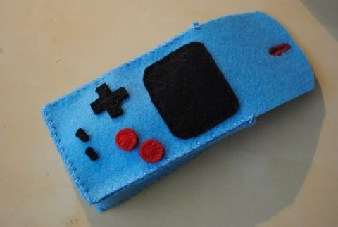 A Camera Case that looks like a Gameboy - made of felt .  Make a pouch, purse or wallet in under 150 minutes by sewing with felt and yarn. Inspired by super mario, vintage & retro, and gameboy. Creation posted by Roula Rouge. Difficulty: Easy. Cost: Absolutley free.