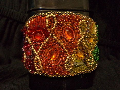 Beaded Bling .  Make a beaded cuff by beading, needleworking, and embroidering with beads, glue, and rhinestones. Inspired by clothes & accessories. Creation posted by Anria O. Difficulty: Simple. Cost: 3/5.