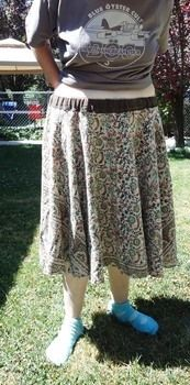 Table cloth Circle Skirt .  Sew a gathered skirt in under 60 minutes by sewing with fabric. Inspired by vintage & retro and clothes & accessories. Creation posted by Recycled Miracles. Difficulty: Easy. Cost: No cost.