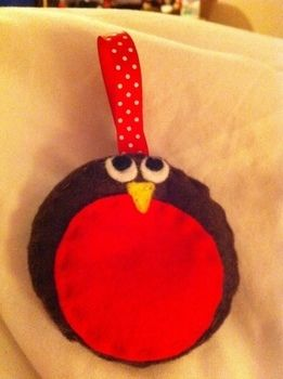 Cute little fella! .  Make a Christmas tree ornament in under 20 minutes by sewing with felt, thread, and ribbon. Inspired by christmas. Creation posted by Jess. Difficulty: Easy. Cost: No cost.