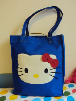 Made with a little creativity. .  Sew an applique tote in under 120 minutes by decorating, embellishing, and sewing with fabric. Inspired by hello kitty and kawaii. Creation posted by Joanne N. Difficulty: 3/5. Cost: 3/5.